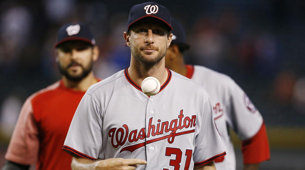 Max Scherzer hits home run, leaves game with apparent injury