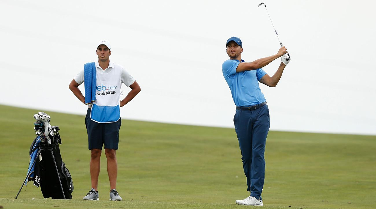 Stephen Curry plays an approach shot to the ninth green during round one of the Ellie Mae Classic at TCP Stonebrae.