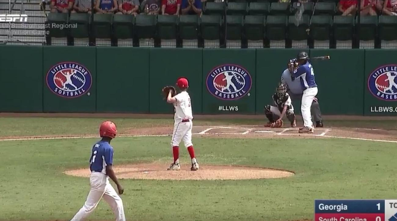Little Leaguer smacks grand slam to trees on cue from announcer