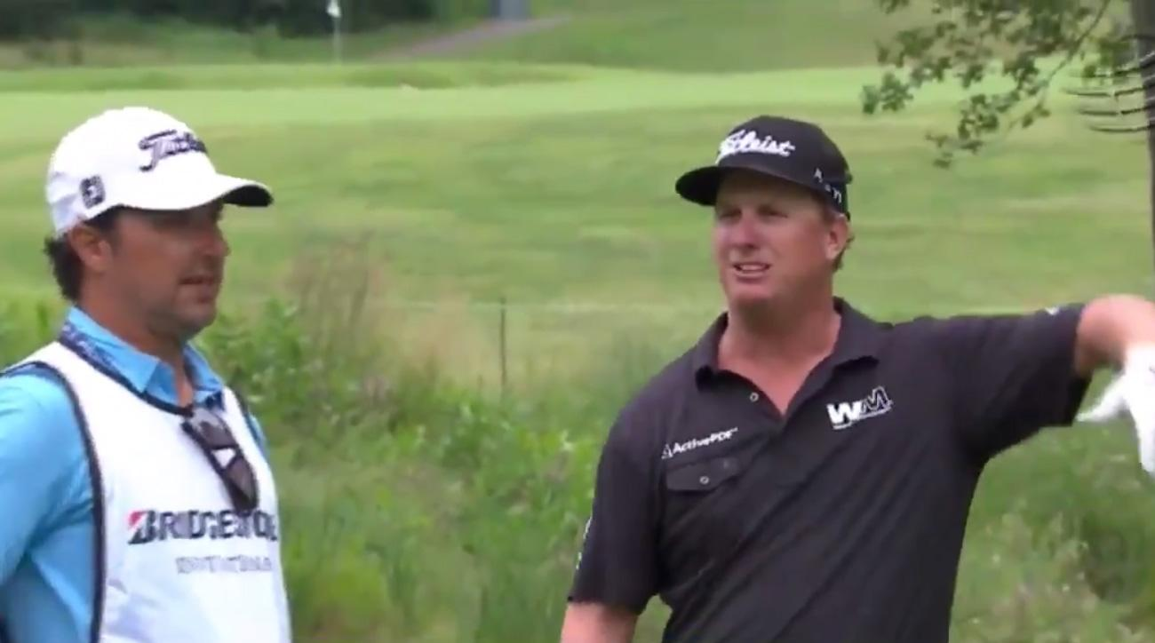 Charley Hoffman debates his caddie over how to play the par-5 16th hole Sunday at the WGC-Bridgestone