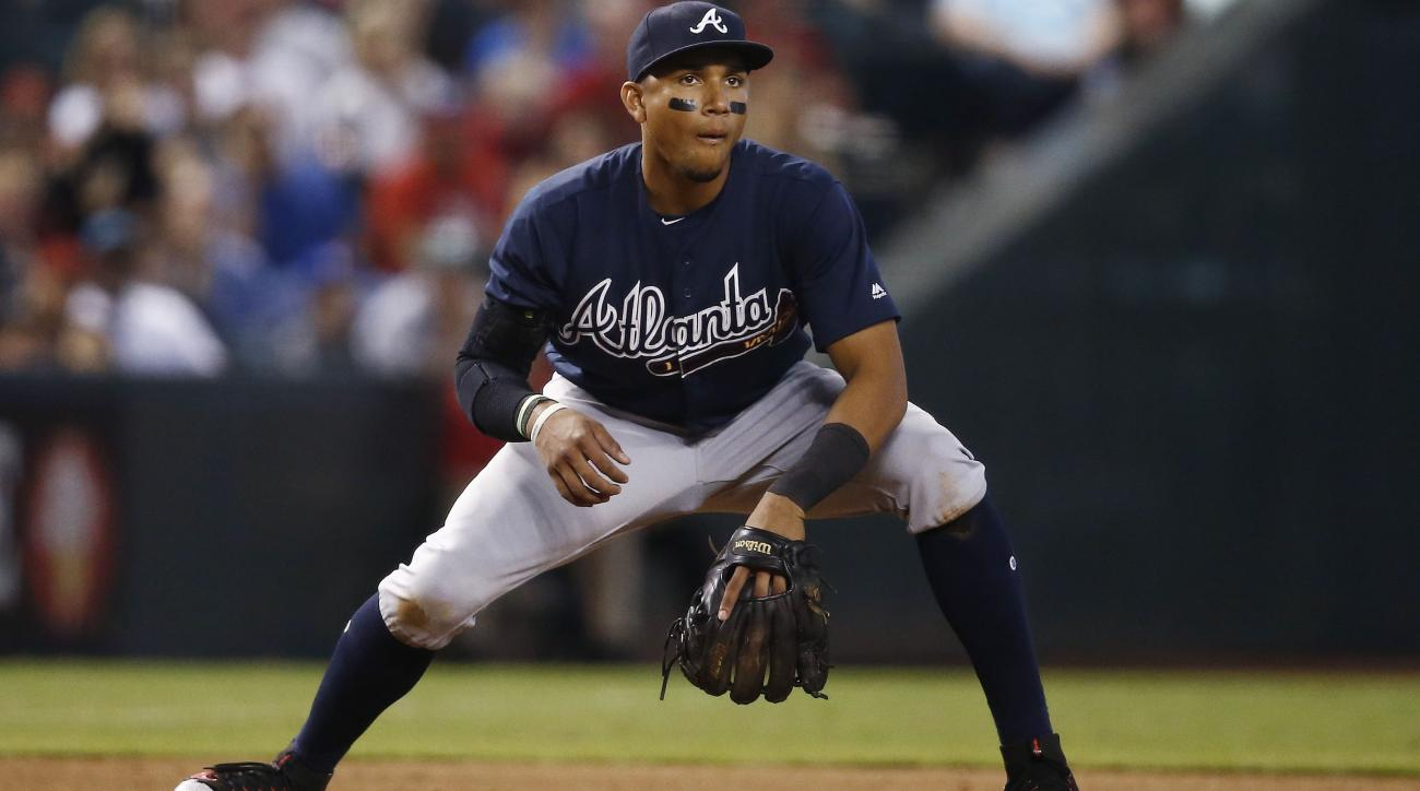 new products e60ae 24efa Johan Camargo: Braves' IF injured running onto the field ...