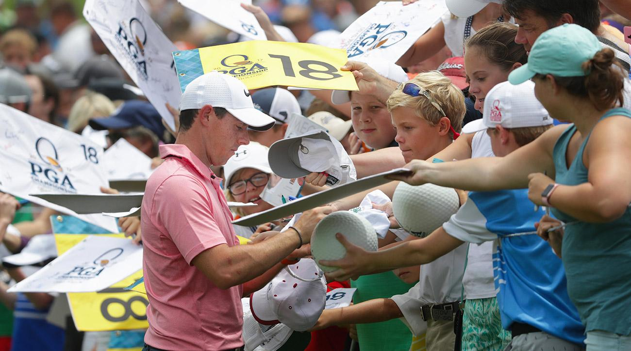 Rory McIlroy signs autographs at Quail Hollow on Monday.