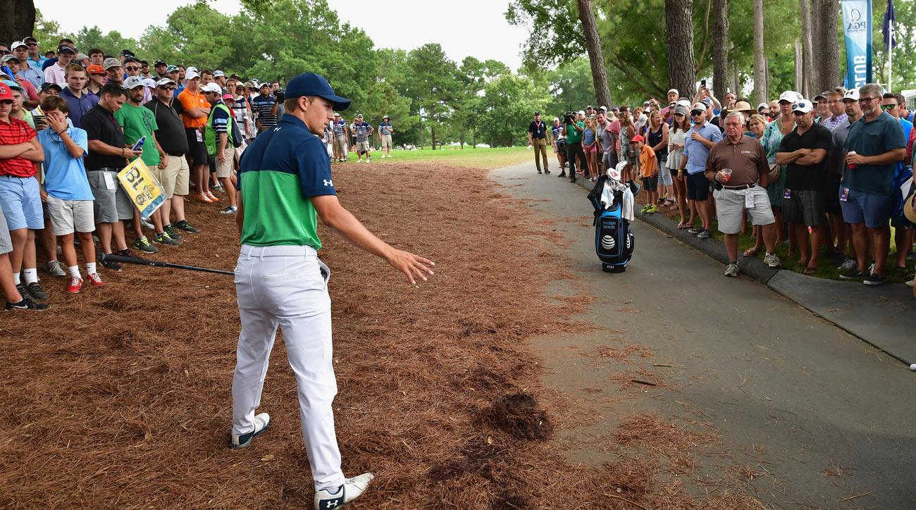 Under the rules of golf, Jordan Spieth was allowed to clear away pine needles before taking a drop on the 10th hole Friday.
