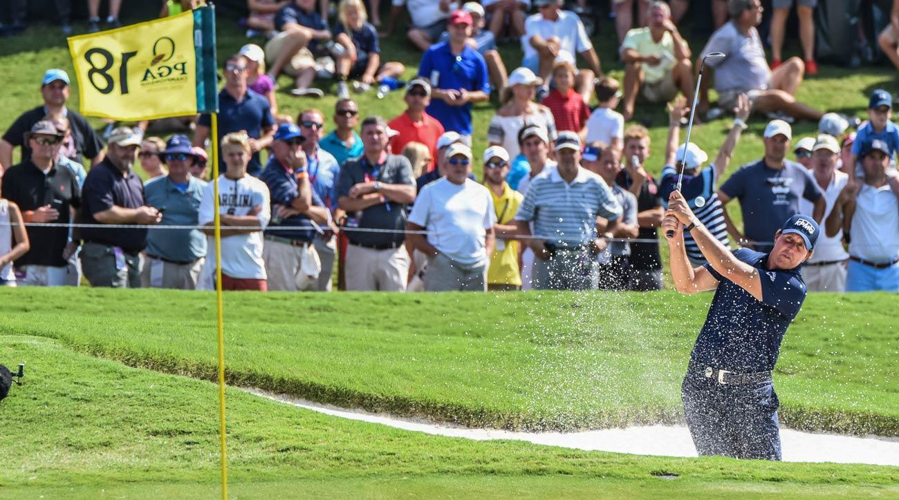 Phil Mickelson blasts a shot out of the bunker on the 18th hole during the second round of the PGA Championship.