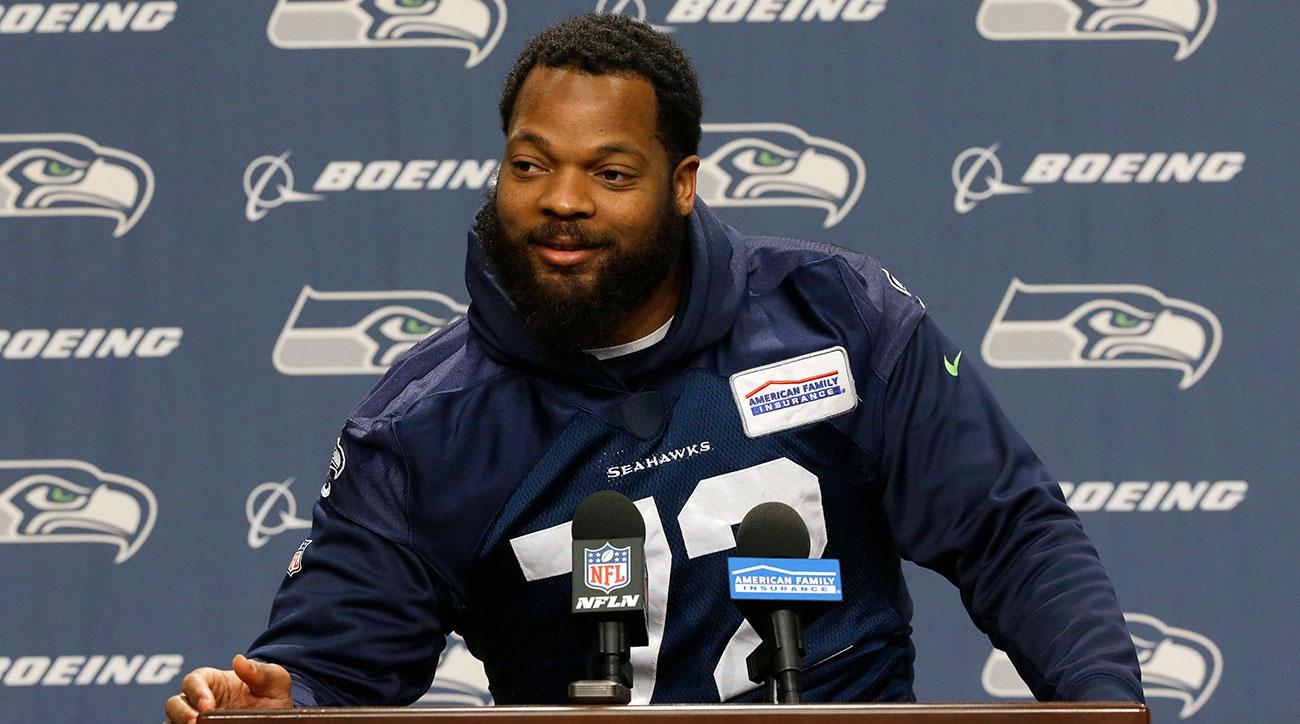 Seattle Seahawks defensive end Michael Bennett talks to reporters, Tuesday, Jan. 10, 2017, in Renton, Wash. The Seahawks play the Atlanta Falcons in an NFC divisional playoff NFL football game, Saturday, Jan. 14, 2017 in Atlanta (AP Photo/Ted S. Warren)