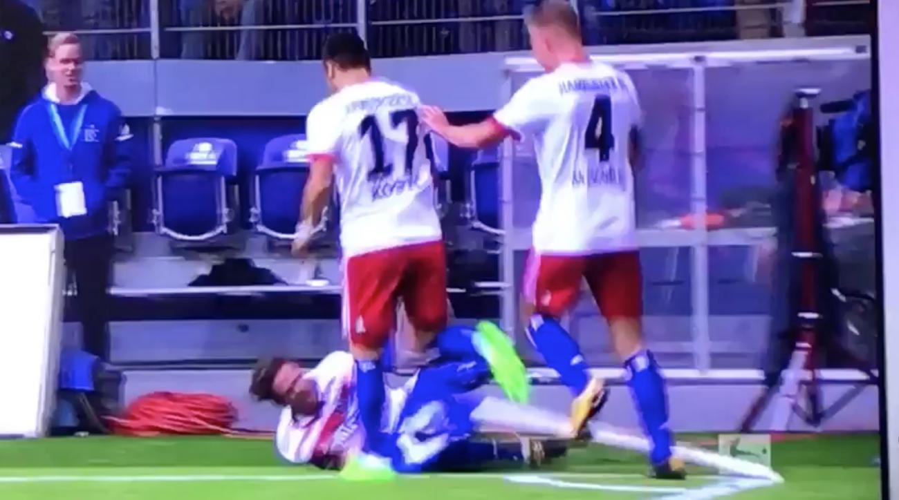 Hamburg's Nicolai Muller injured himself celebrating his opening goal against Muller.