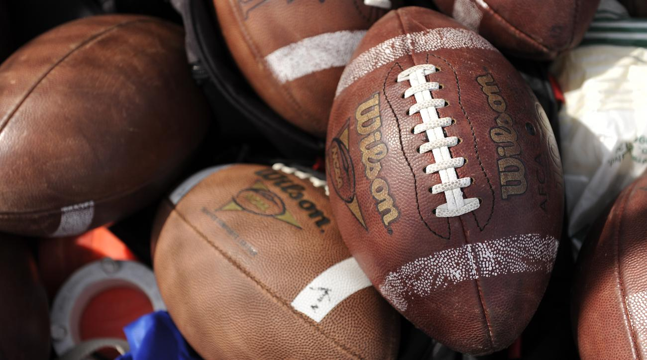 Boy, 14, dies after collapsing at high school football practice
