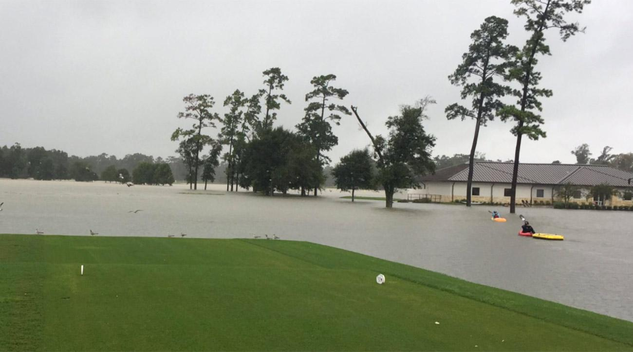 Kayakers paddle near the first tee at the Golf Club of Houston.