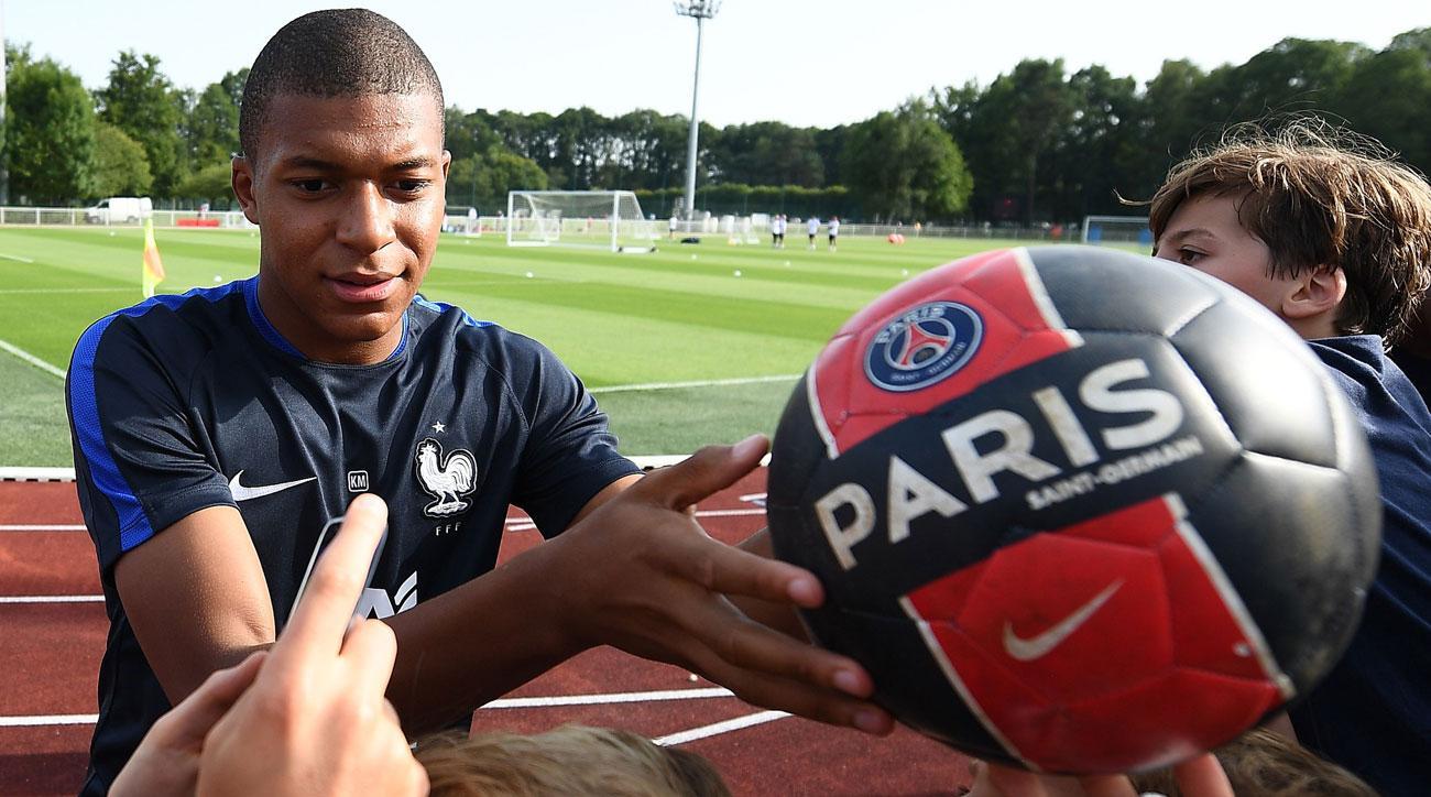 Kylian Mbappe joins PSG on loan from Monaco
