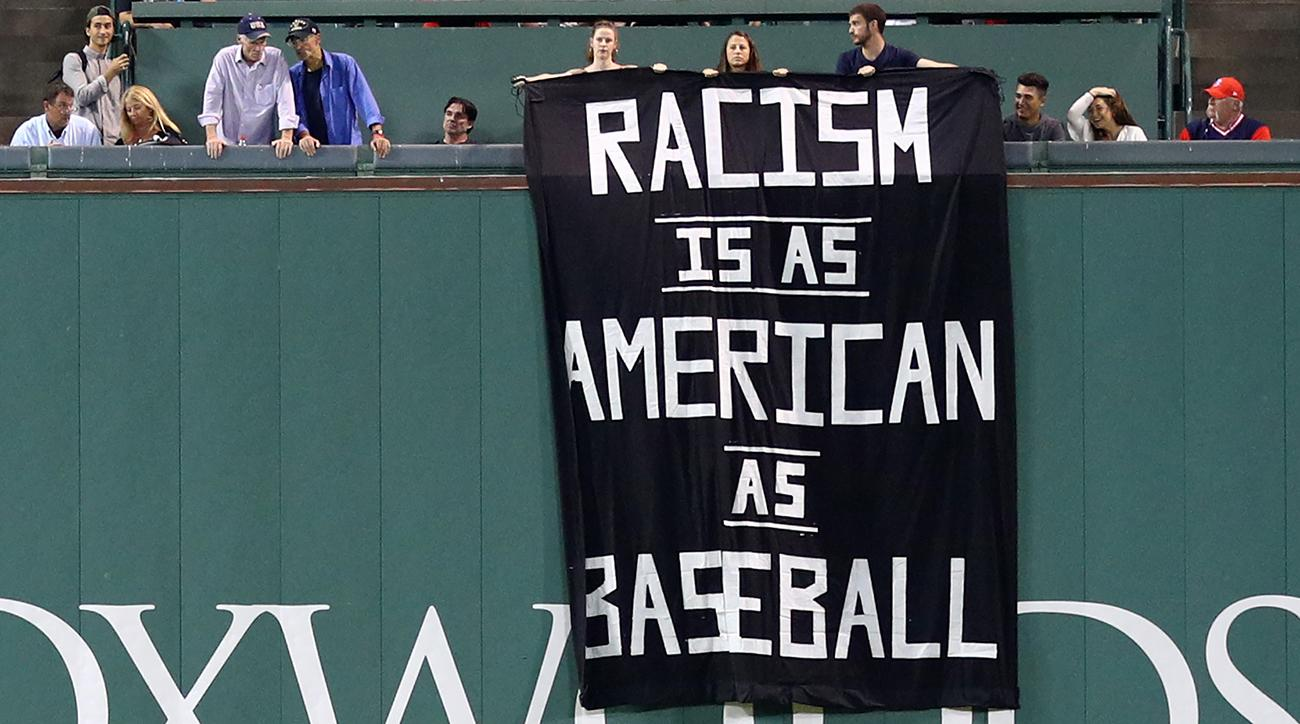 racism is as american as basell banner appears at fenway si com