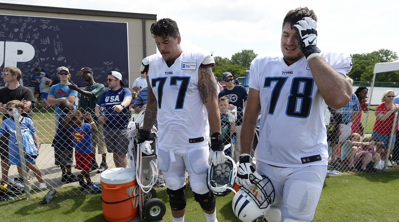 Tennessee tackles Taylor Lewan and Jack Conklin take a break during training camp.