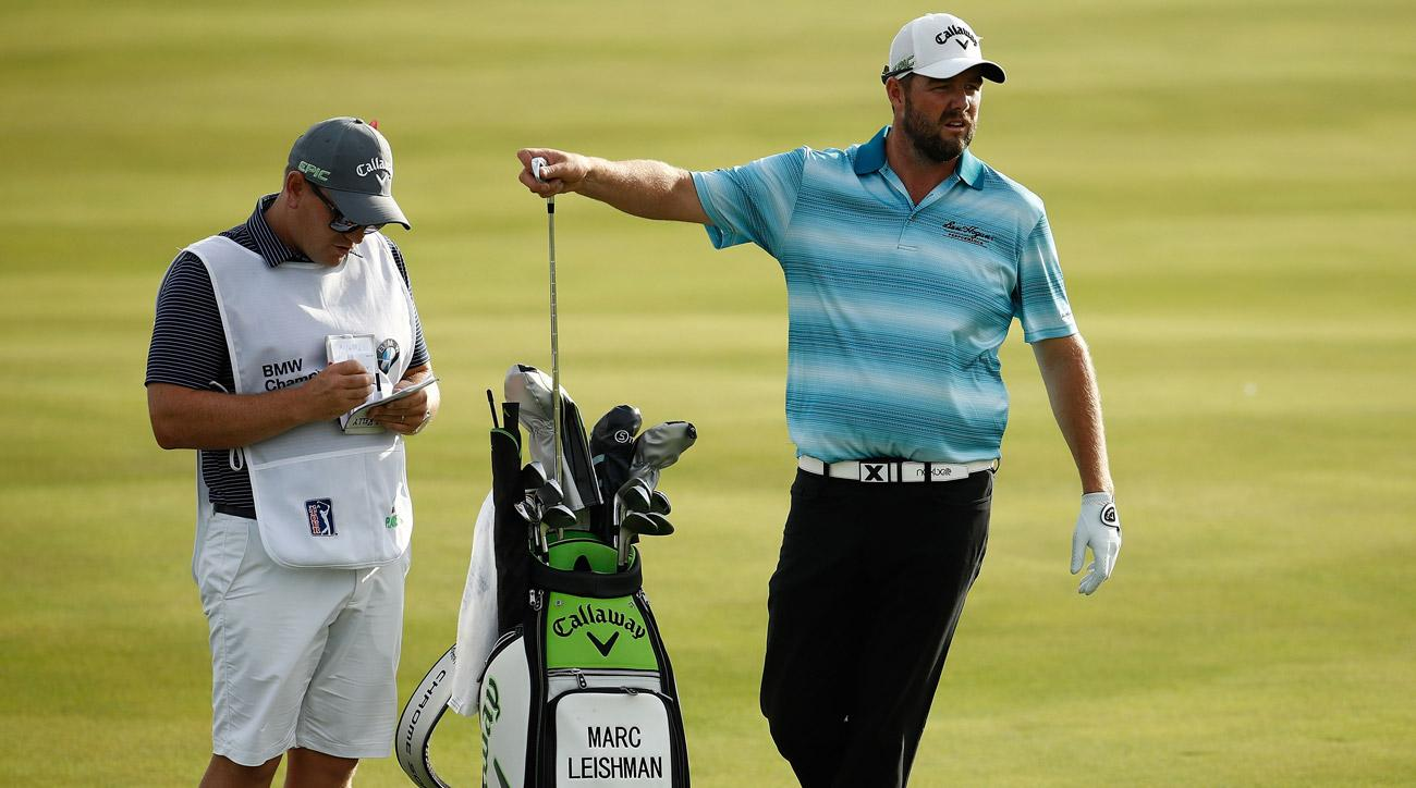 Marc Leishman pulls a club from his bag in the 18th fairway during the final round of the BMW Championship.