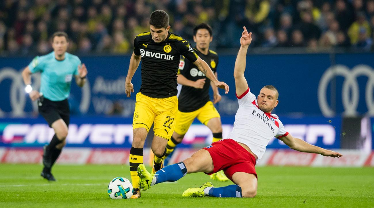 Dortmund express crushes Hamburg 3-0 to stay top