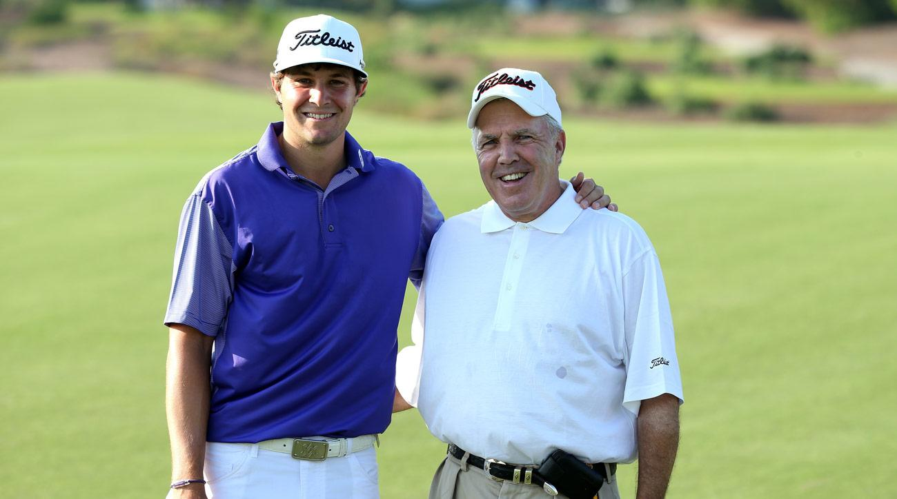 Wally Uihlein poses for a photograph with his son Peter Uihlein during practice prior to the start of the 2013 DP World Tour Championship.
