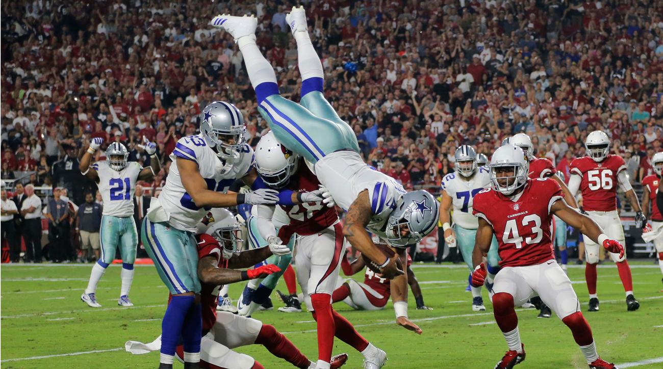 Dallas Cowboys quarterback Dak Prescott dives into the end zone.