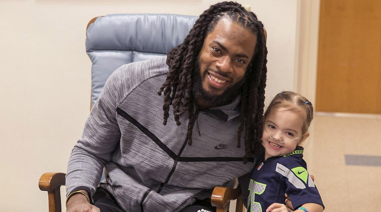 Richard Sherman helps out a young patient who lost her 'Shermie' doll