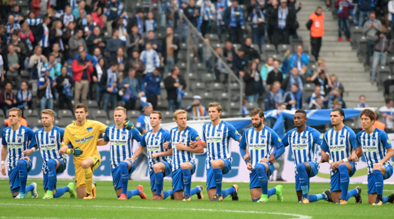 German soccer team Hertha Berlin takes a knee