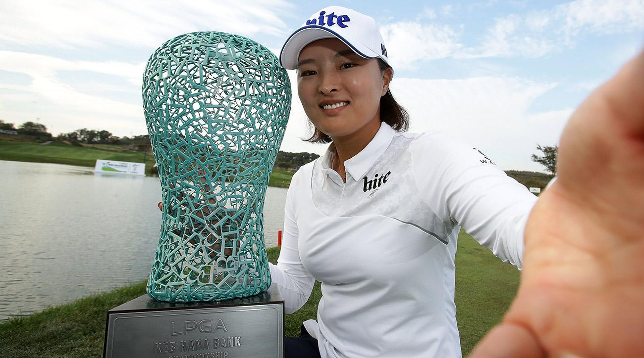 Jin Young Ko poses with the trophy following the LPGA KEB Hana Bank Championship on Sunday.