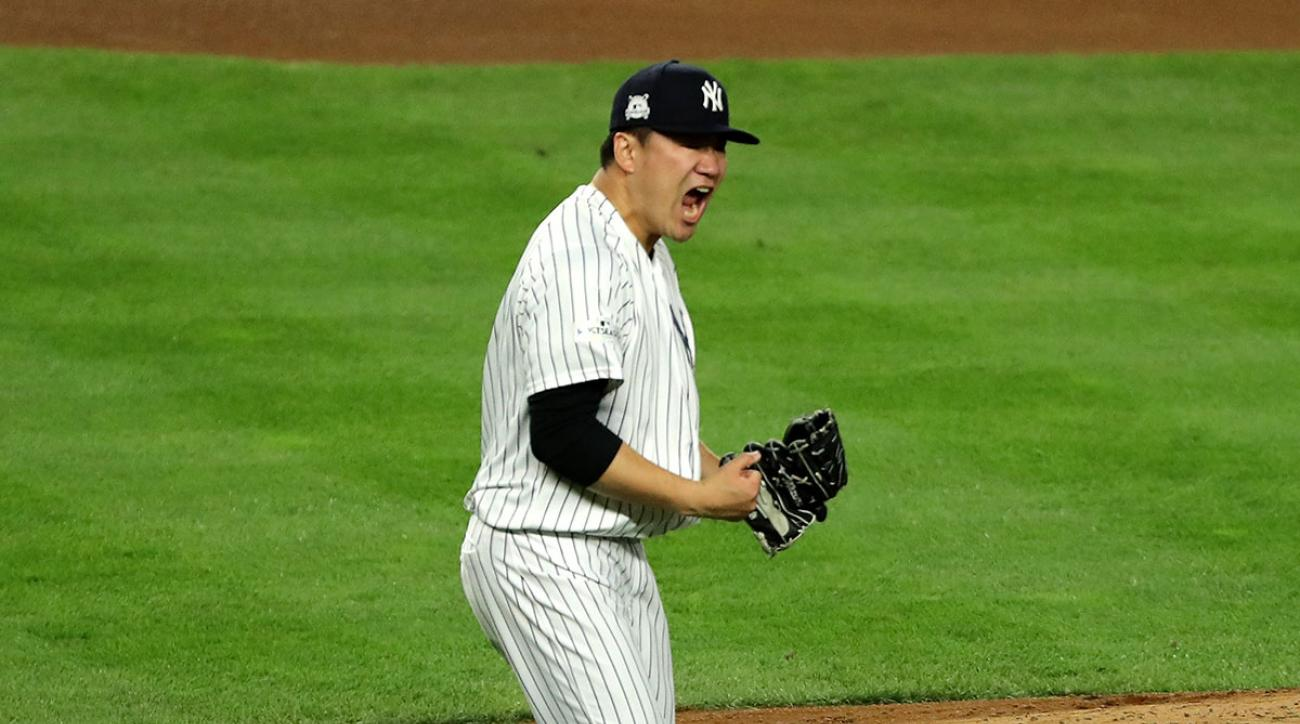 Masahiro Tanaka #19 of the New York Yankees reacts after striking out Josh Reddick #22 of the Houston Astros to end the top of the fifth inning in Game Five of the American League Championship Series at Yankee Stadium on October 18, 2017 in the Bronx bor