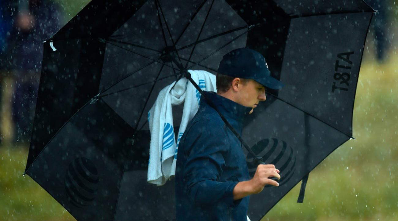 Jordan Spieth attempts to stay dry during the 2017 British Open at Royal Birkdale.