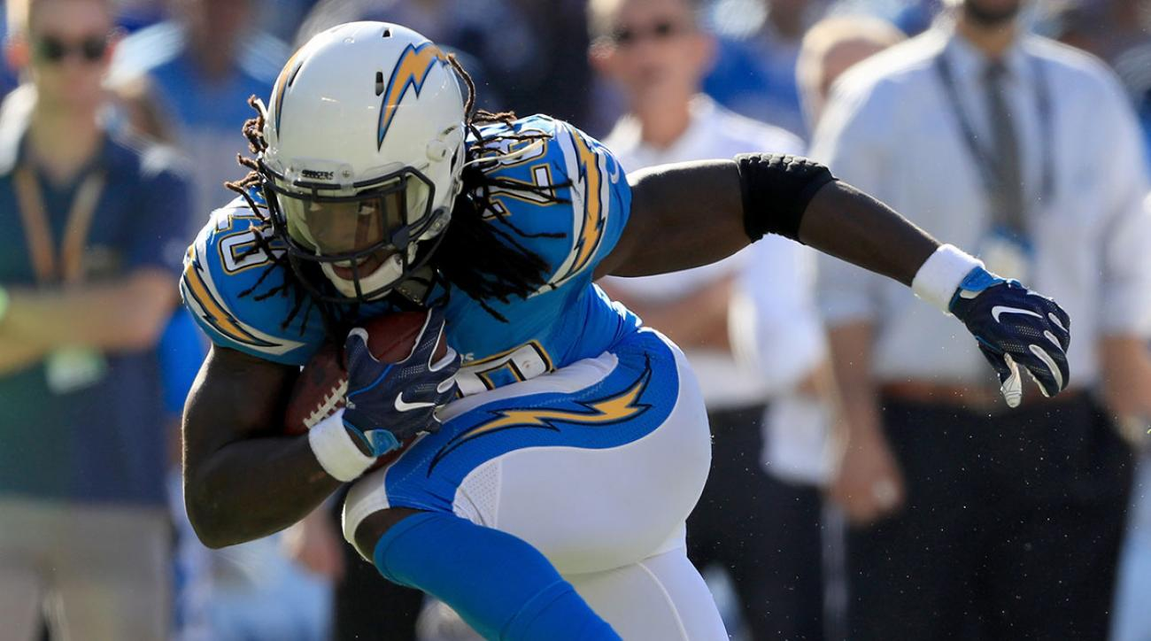 Melvin Gordon #28 of the San Diego Chargers runs past Perrish Cox #20 of the Tennessee Titans in the first half at Qualcomm Stadium on November 6, 2016 in San Diego, California. (Photo by Sean M. Haffey/Getty Images)