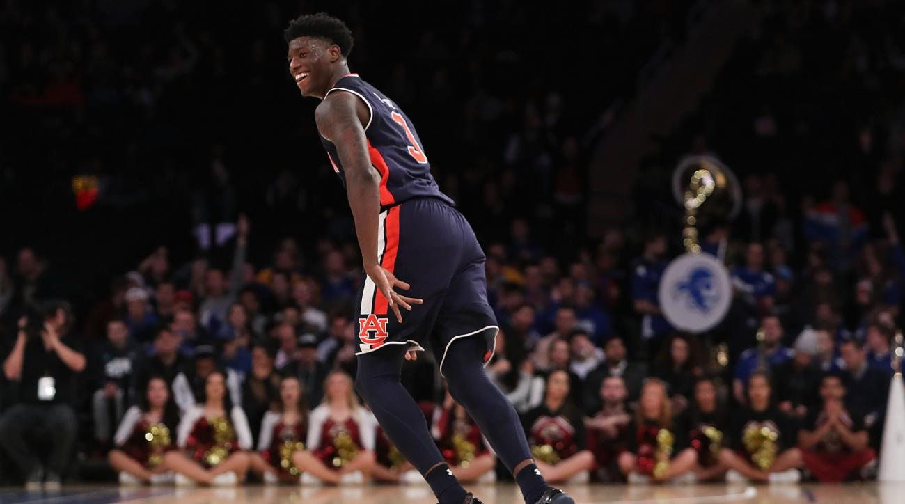 Auburn has suspended Austin Wiley and Danjel Purifoy indefinitely after two players were accused of receiving bribes in the FBI's complaint against Chuck Person.