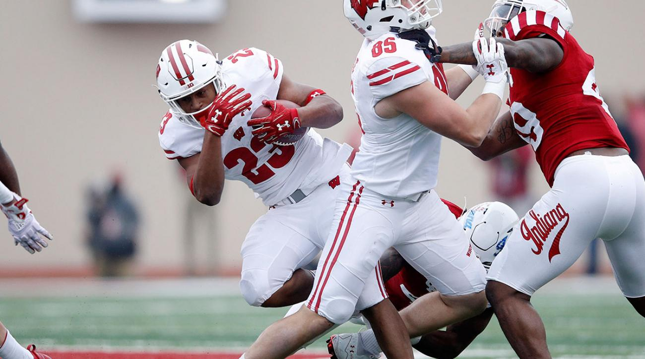 Jonathan Taylor #23 of the Wisconsin Badgers tries to run behind a block from Zander Neuville #85 in the second quarter of a game against the Indiana Hoosiers at Memorial Stadium on November 4, 2017 in Bloomington, Indiana. (Photo by Joe Robbins/Getty Images)