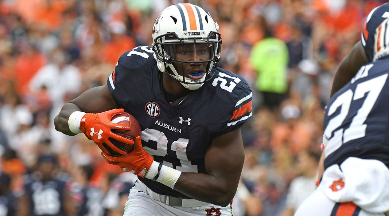 Auburn running back Kerryon Johnson (21) runs the ball during the first half of an NCAA college football game against Mississippi in Auburn, Ala., Saturday, Oct. 7, 2017. (AP Photo/Thomas Graning)