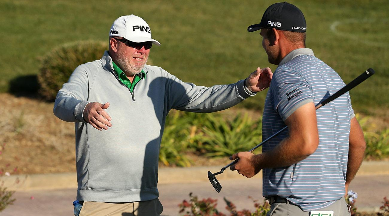 Jonathan Thomson hugs his tearful father after shooting two-under 69 at Lumine Golf Club to earn his European tour card.