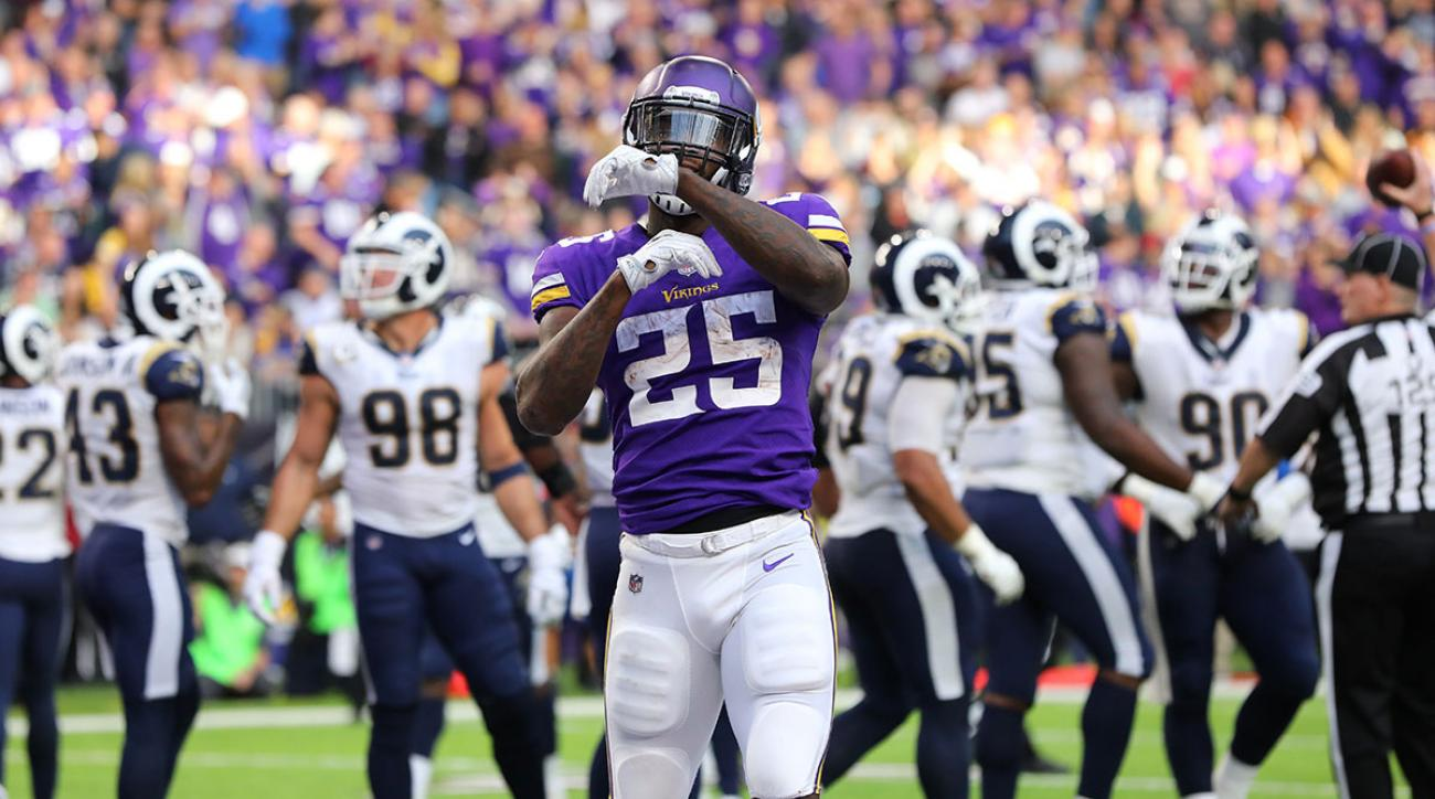 Latavius Murray #25 of the Minnesota Vikings celebrates after scoring a two yard rushing touchdown in the fourth quarter of the game against the Los Angeles Rams on November 19, 2017 at U.S. Bank Stadium in Minneapolis, Minnesota. (Photo by Adam Bettcher/Getty Images)