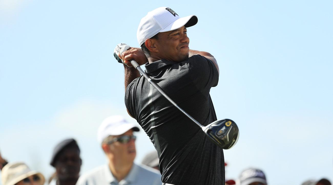 Tiger Woods plays his shot from the sixth tee during the first round of the Hero World Challenge.