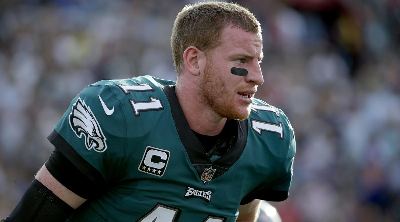 Carson Wentz out with knee injury, sources say possible ACL tear