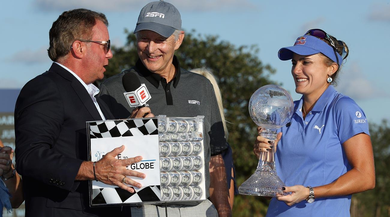 Lexi Thompson is presented with the CME Race for the Globe trophy after the final round of the CME Group Tour Championship.