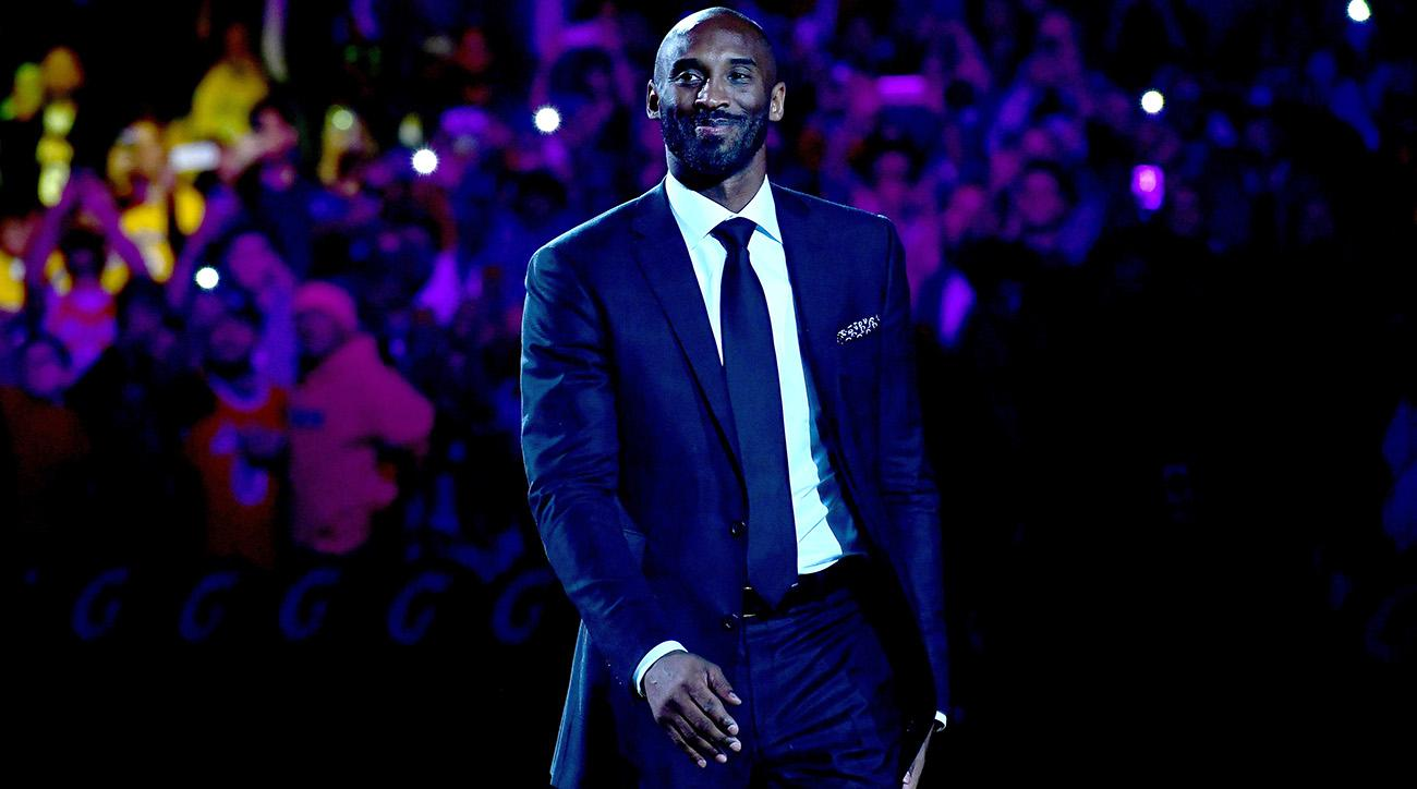 Watch Kobe Bryant's reaction as his Lakers jerseys were retired