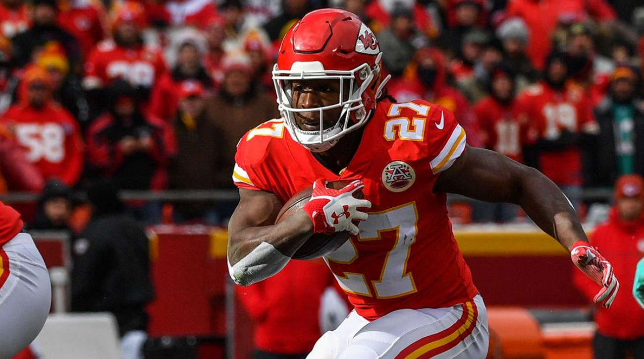 Running back Kareem Hunt #27 of the Kansas City Chiefs rushes through a hole during the first quarter of the game against the Miami Dolphins at Arrowhead Stadium on December 24, 2017 in Kansas City, Missouri. ( Photo by Peter Aiken/Getty Images )
