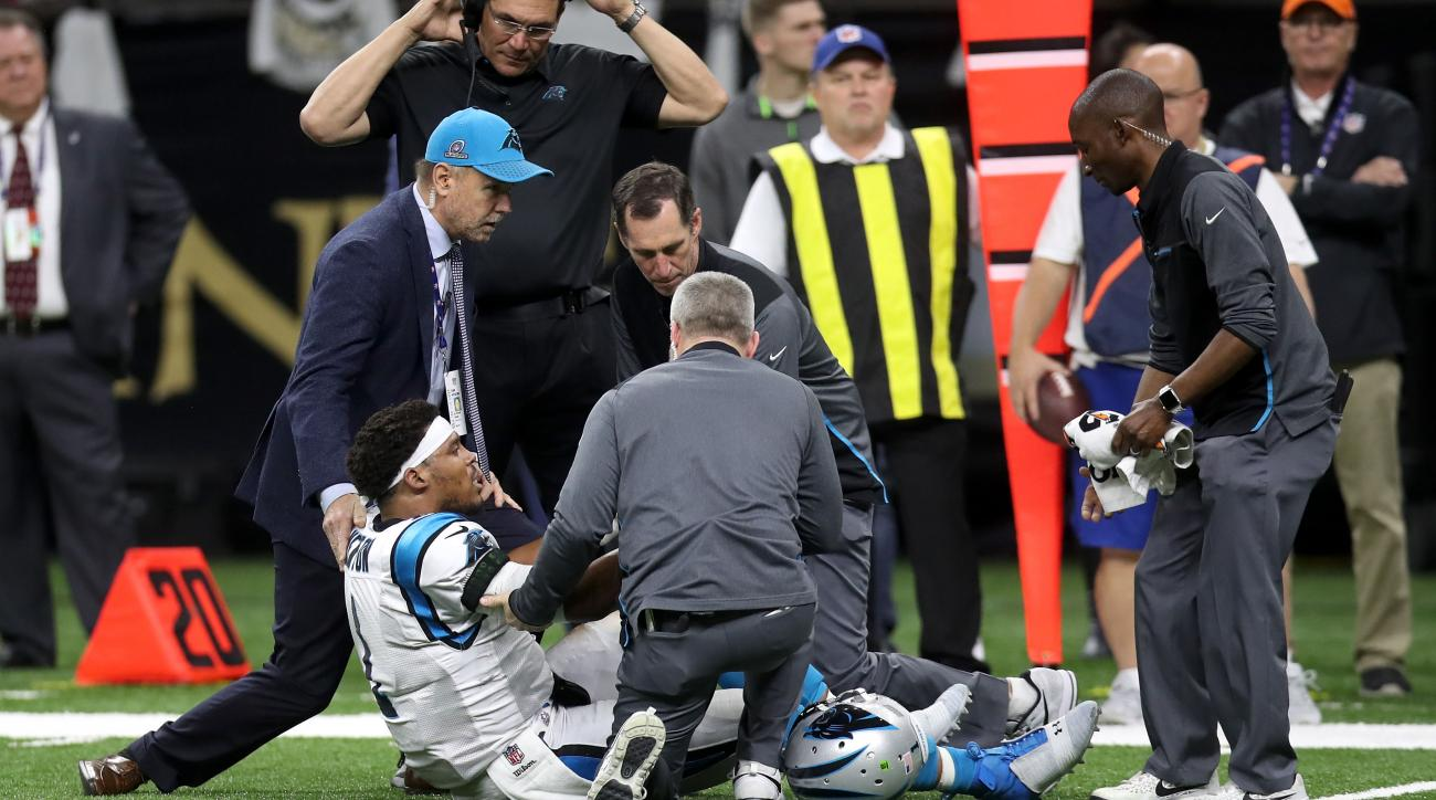 Cam Newton crumples trying to leave field in scary scene