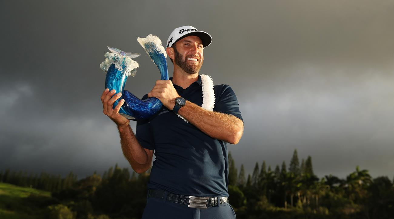 Dustin Johnson celebrates with the winner's trophy after the final round of the 2018 Sentry Tournament of Champions.
