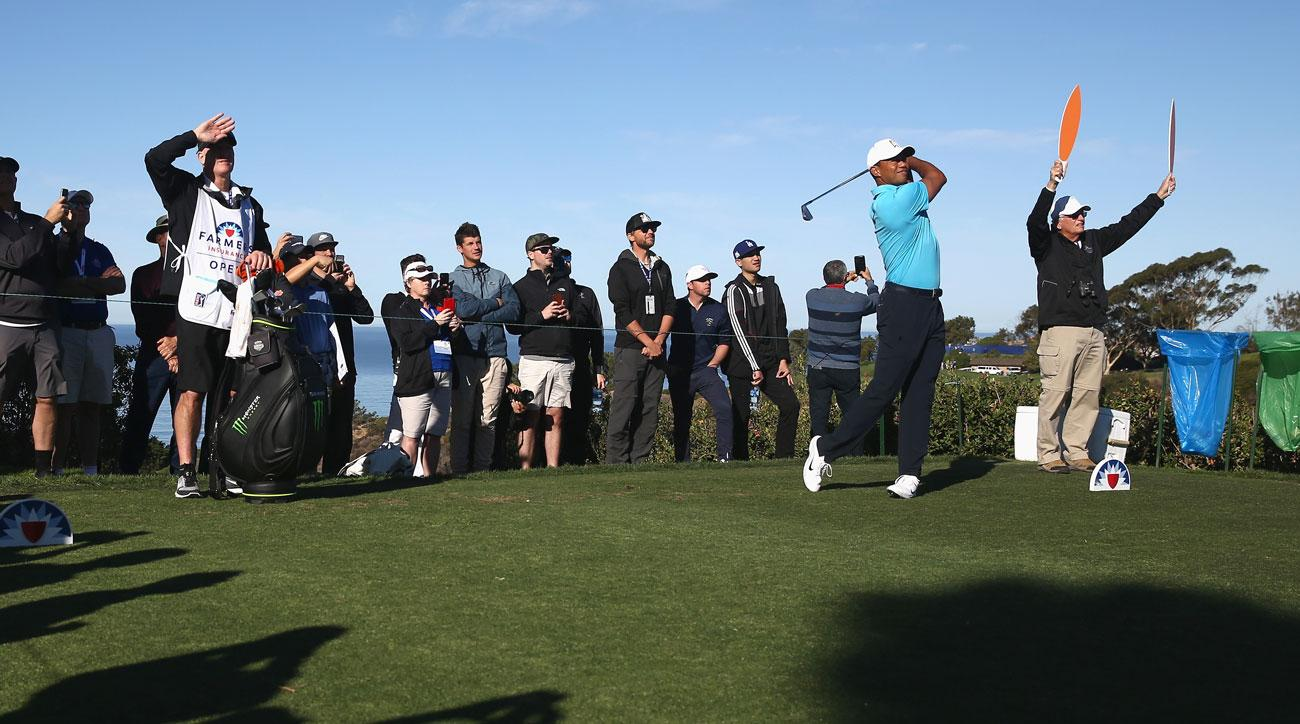 Tiger Woods hits a shot on the 12th during the pro-am round of the Farmers Insurance Open at Torrey Pines.