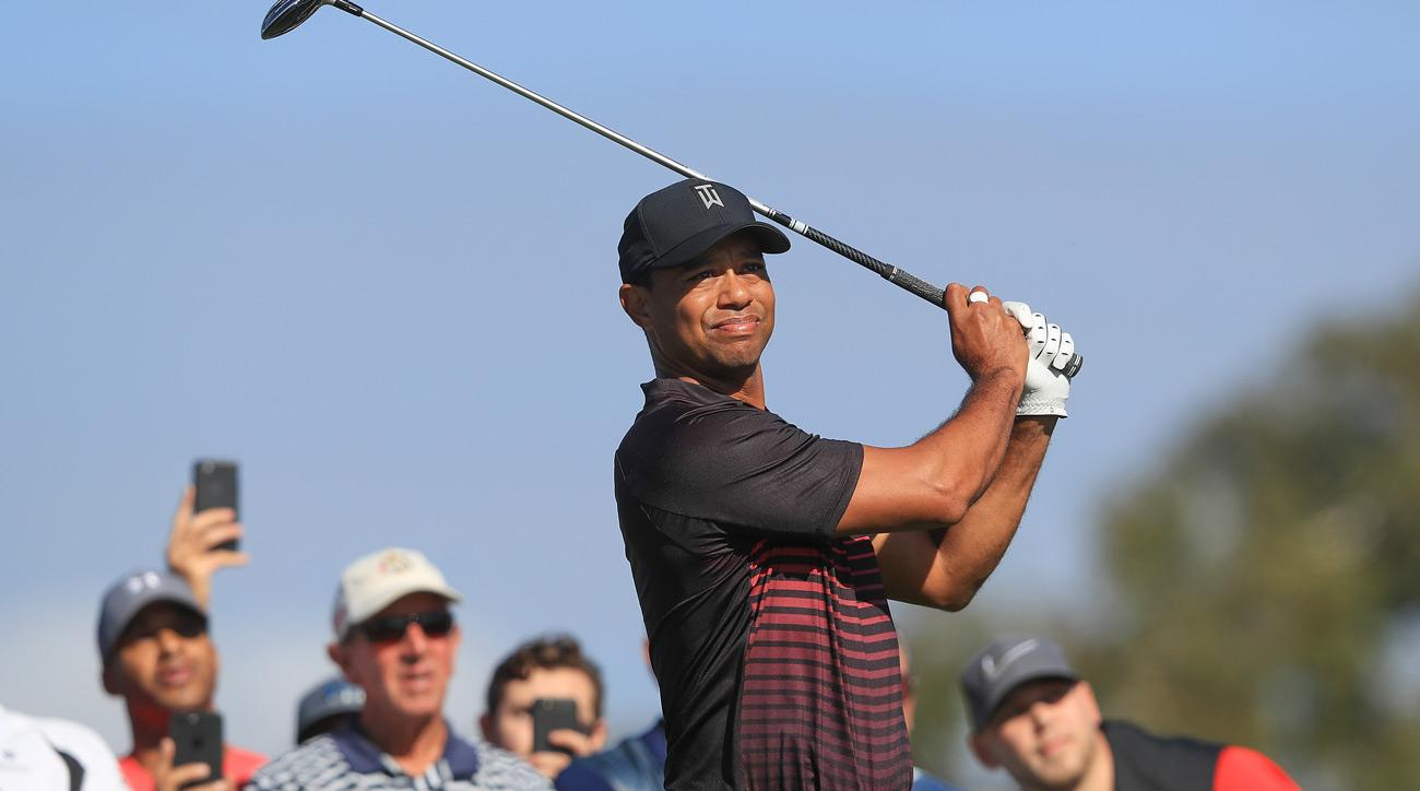 Tiger Woods plays his shot from the second tee during the first round of the Farmers Insurance Open.