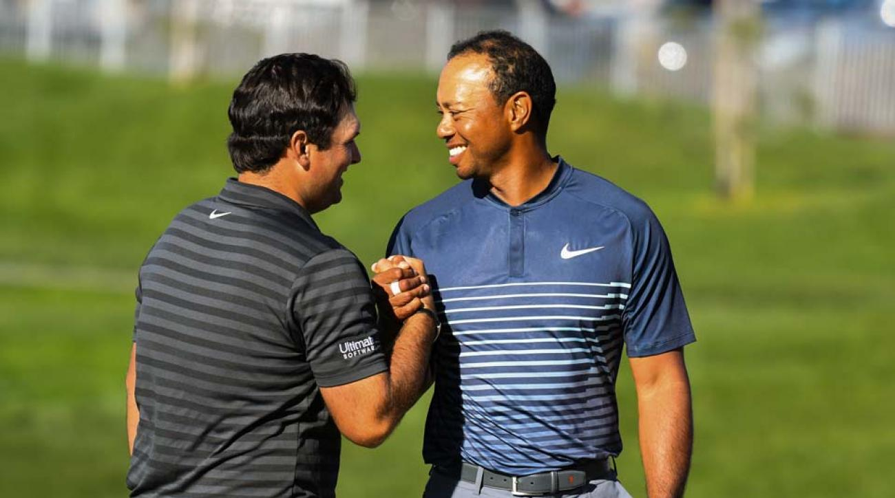 Patrick Reed and Tiger Woods share a moment after completing their second round at the Farmers Insurance Open.