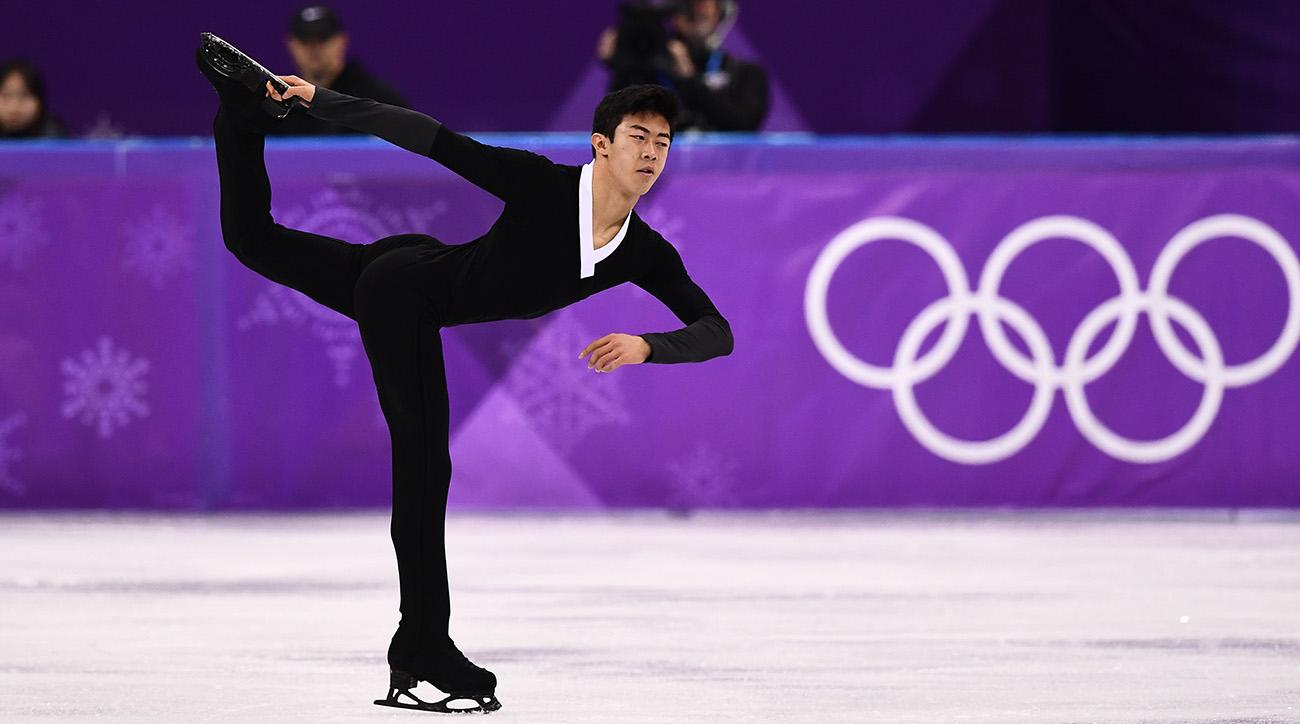 Hanyu defends gold in men's figure skating