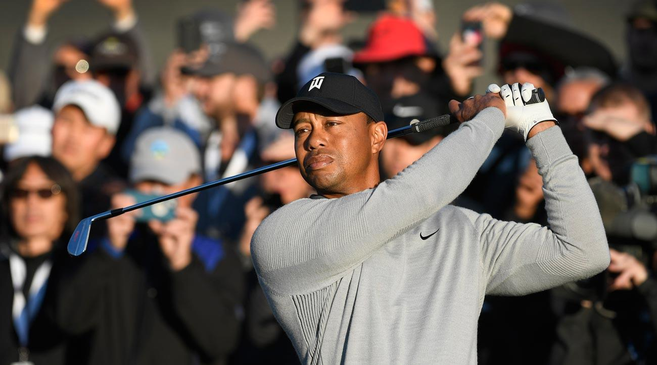Tiger Woods plays a tee shot on the tenth hole during the first round of the 2018 Genesis Open.