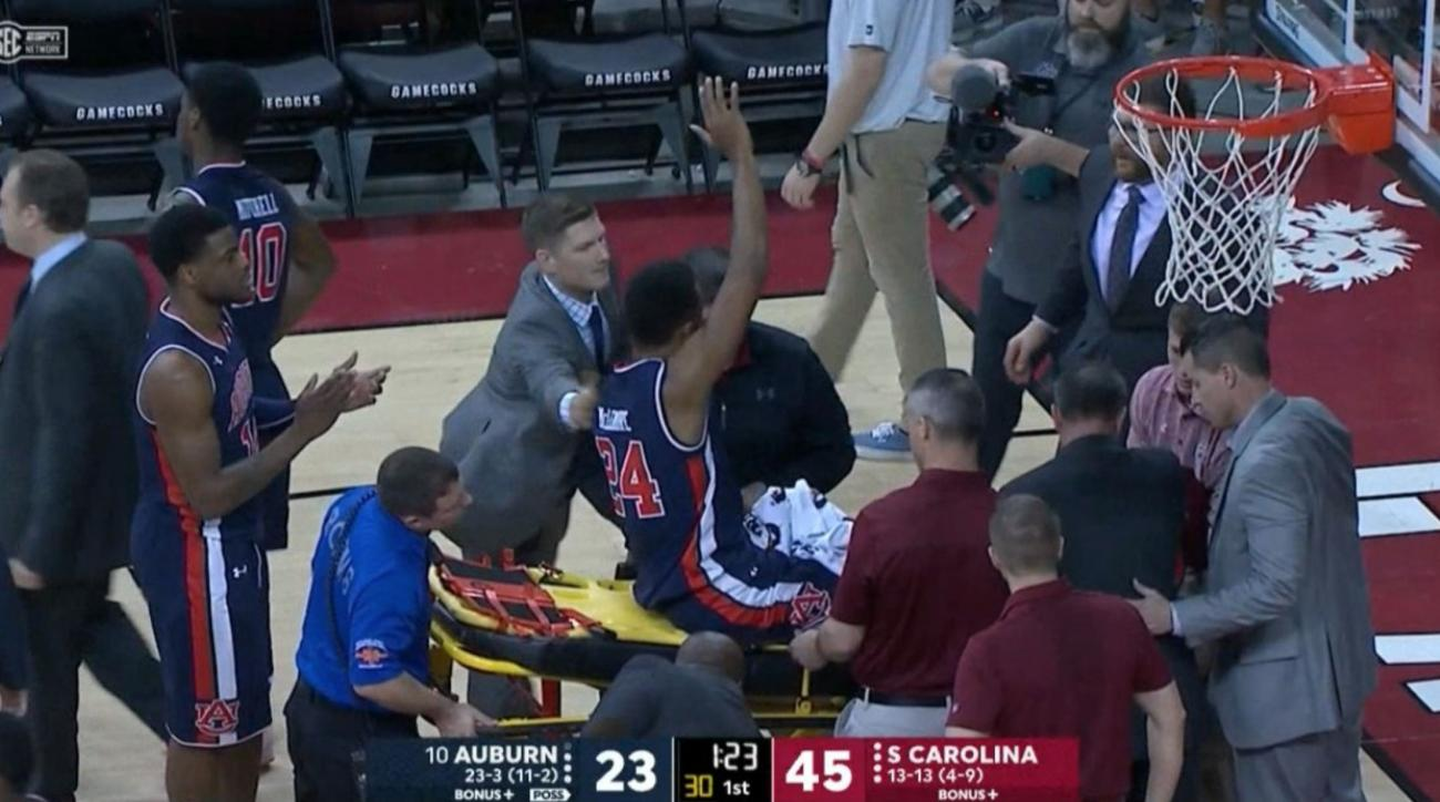 Auburn's Anfernee McLemore carried off on stretcher after dislocated ankle