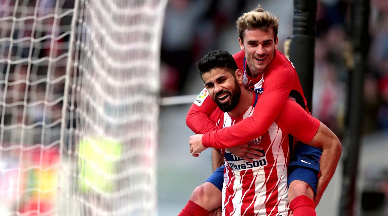 Griezmann hat-trick sees Atletico Madrid trounce Sevilla, close in on Barcelona