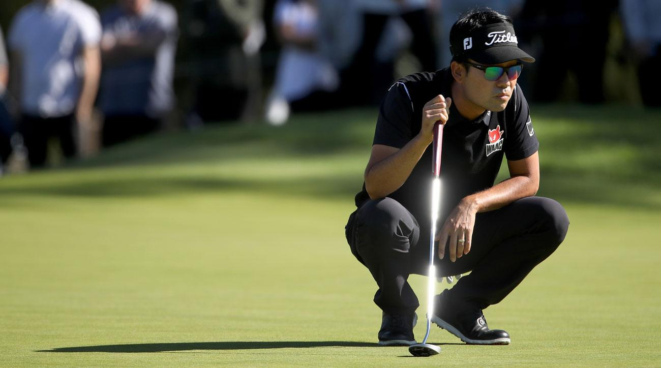 Kevin Na lines up a putt on the first green during the final round of the Genesis Open.