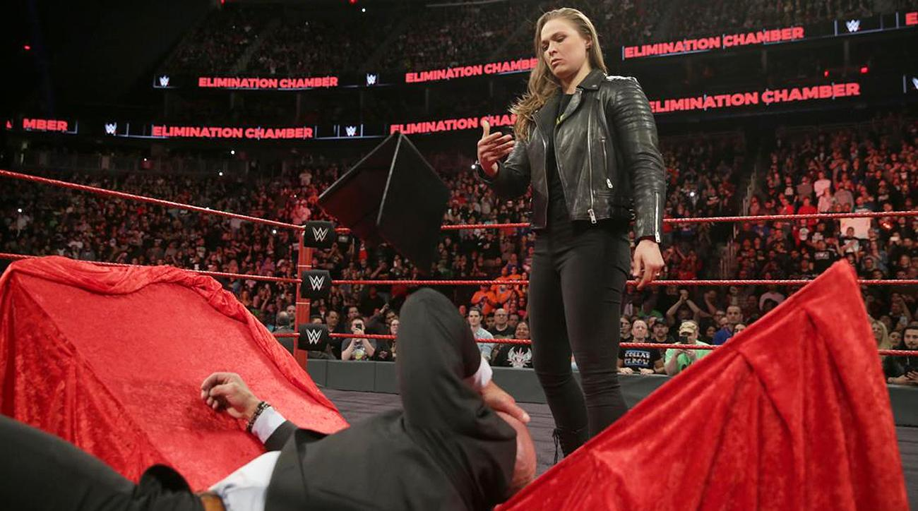 Ronda Rousey slams her way through WWE contract signing