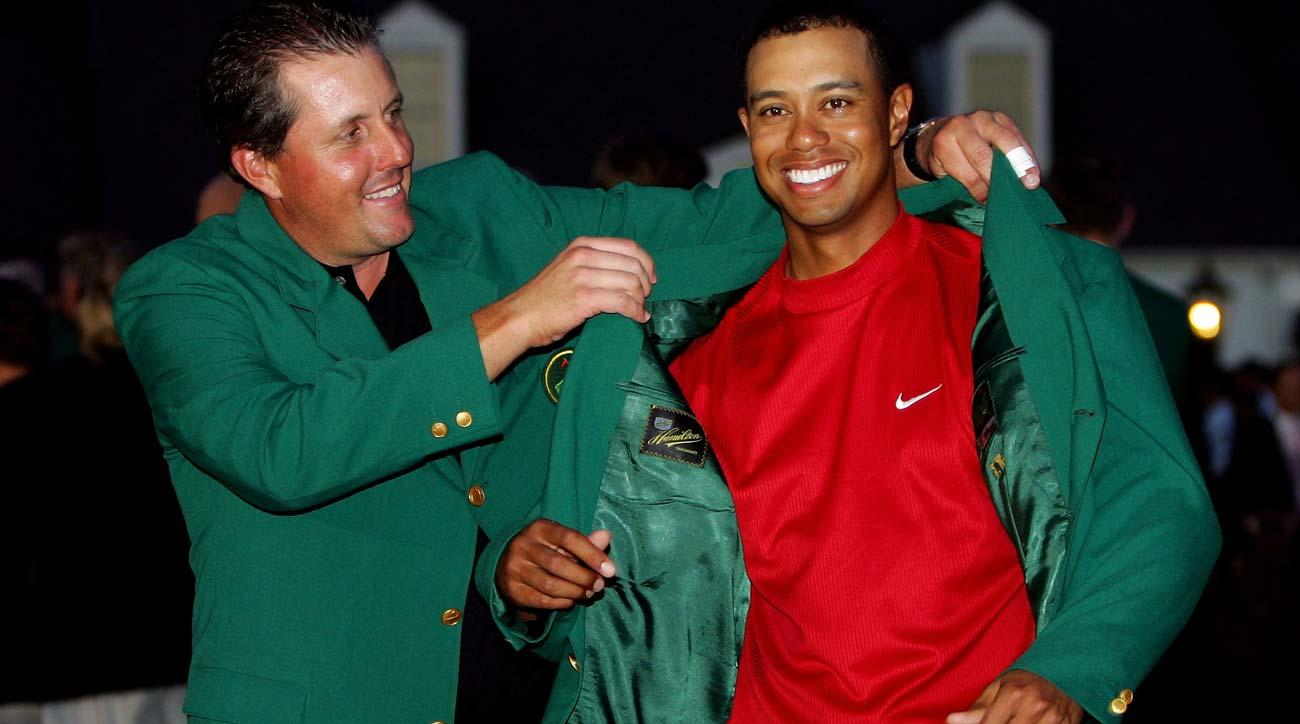 Tiger Woods is presented with the green jacket by Phil Mickelson after Woods won the 2005 Masters at the Augusta National Golf Club