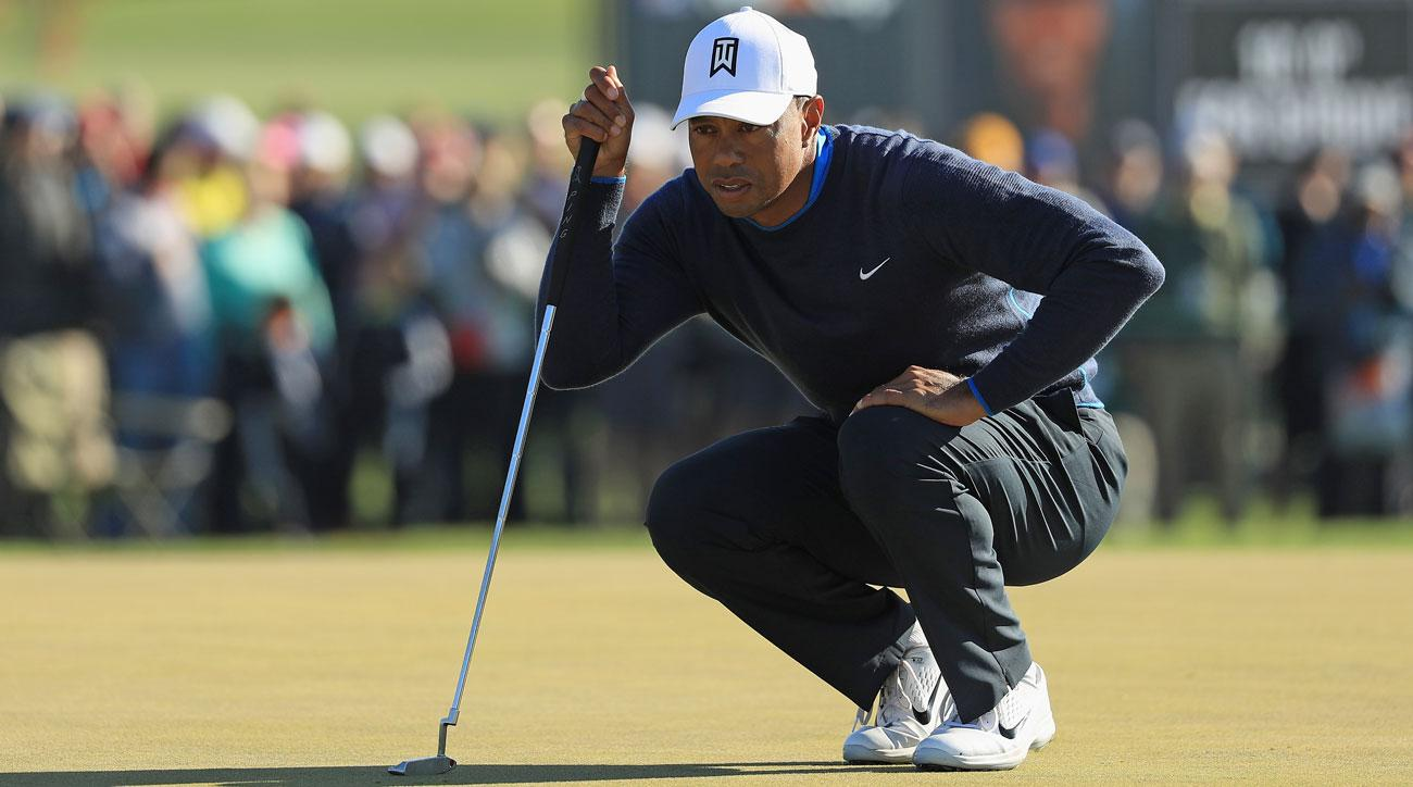 Tiger Woods lines up a putt on the 14th green during the first round at the Arnold Palmer Invitational.