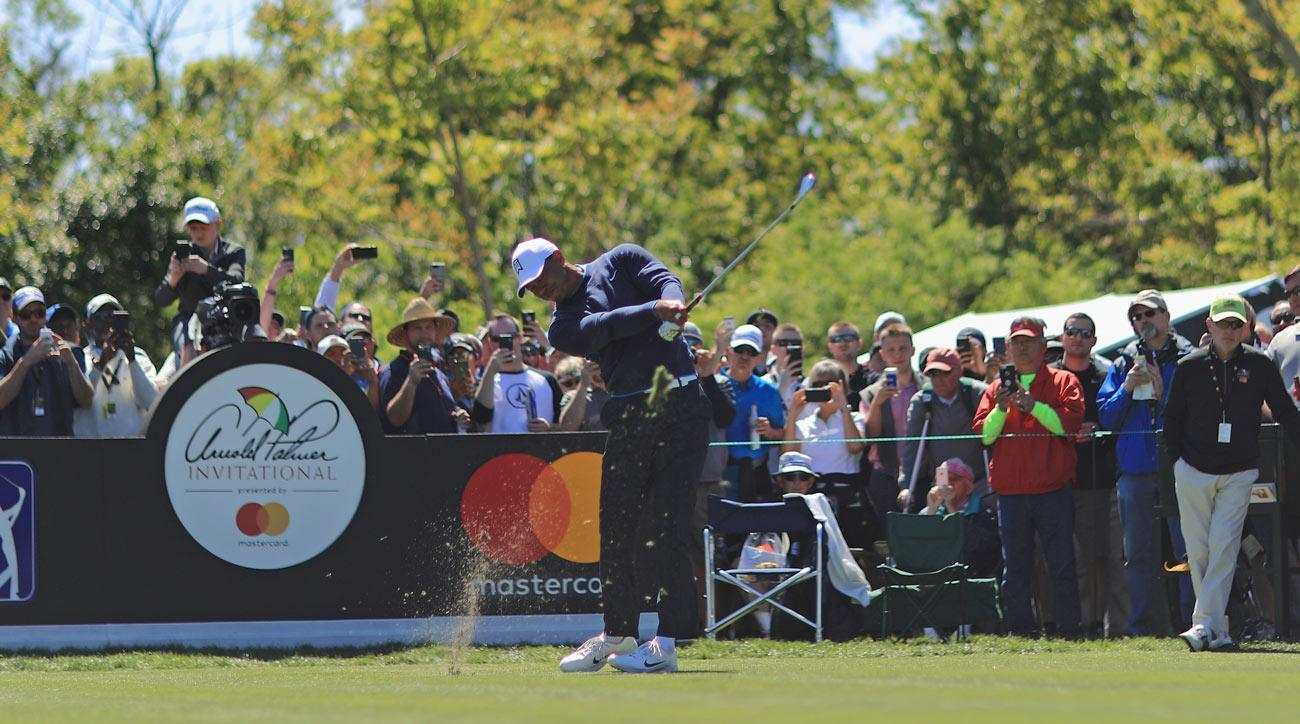 Tiger Woods plays his shot from the seventh tee during the first round at the Arnold Palmer Invitational.