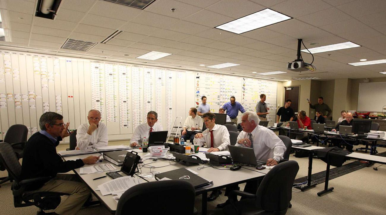 Atlanta Falcons NFL Draft war room.  L- R: Team President Rich McKay, Owner Arthur Blank, GM Thomas Dimitroff and Head Coach Mike Smith